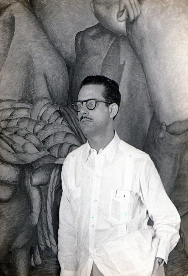 Leovigildo González Morillo y parte de su mural Desarrollo racial y económico de Cuba.
